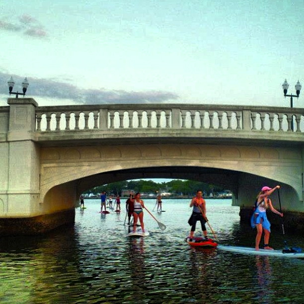stand up paddle under the bridge