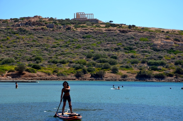 Vie in front of Poseidon's Temple at Cape Sounio in Athens, Greece.